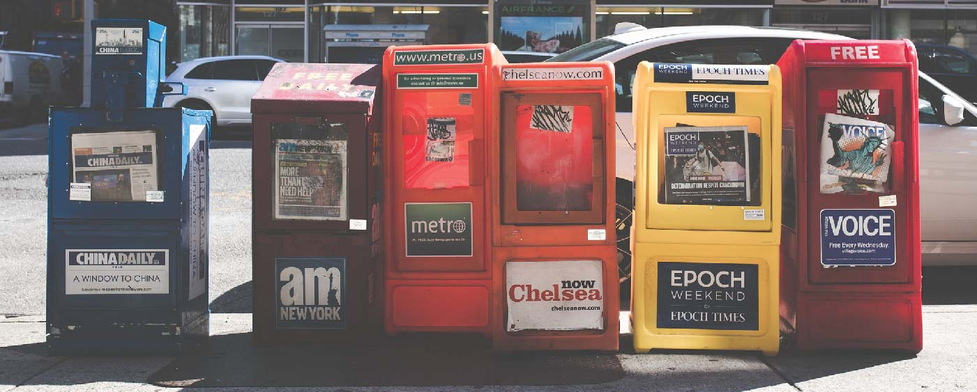 CATMEDIA Press Newspaper boxes lined up on the street.